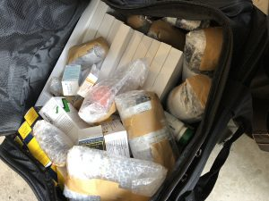 suitcase of medication